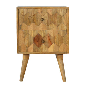 Bogdan Bedside Table comes in an oak finish with a carved style and is available from roomshaped.co.uk