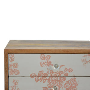 Edith Bedside Table comes in pink and white with a country style and is available from roomshaped.co.uk