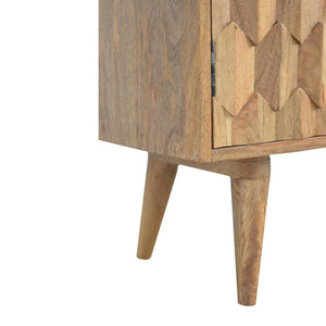 Malik Cupboard comes in an oak finish with a carved style and is available from roomshaped.co.uk