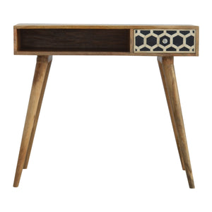 Anna Writing Desk comes in black and an oak finish with a geometric style and is available from roomshaped.co.uk