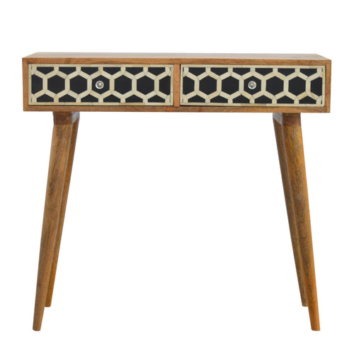 Ania Console Table comes in black and an oak finish with a geometric style and is available from roomshaped.co.uk