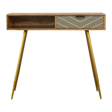 Nova Laptop Desk comes in a gold finish and an oak finish with a geometric style and is available from roomshaped.co.uk