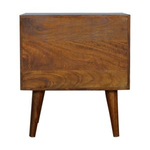 Milos Bedside Table comes in chestnut with a carved style and is available from roomshaped.co.uk