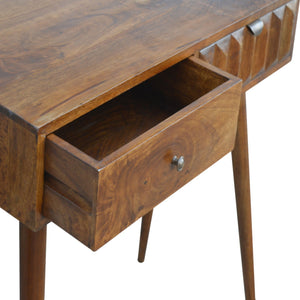 Marmont Console comes in chestnut with a carved style and is available from roomshaped.co.uk