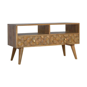 Stella Media Unit comes in an oak finish with a carved style and is available from roomshaped.co.uk