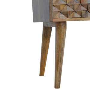 Signe Bedside Table comes in an oak finish with a carved style and is available from roomshaped.co.uk
