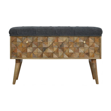 Jeremy Storage Bench comes in an oak finish with a carved style and is available from roomshaped.co.uk