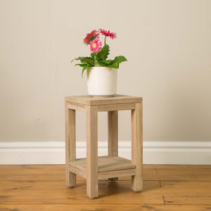 Bagus Plant Stand comes in grey and a natural finish with a city style and is available from roomshaped.co.uk