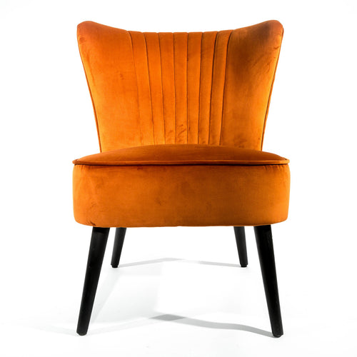 Fern Scallop Chair comes in blue and grey and orange and pink with a luxe style and is available from roomshaped.co.uk