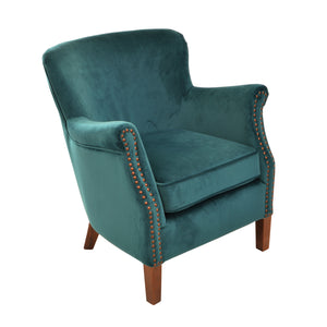 Linda Armchair comes in green with a luxe style and is available from roomshaped.co.uk