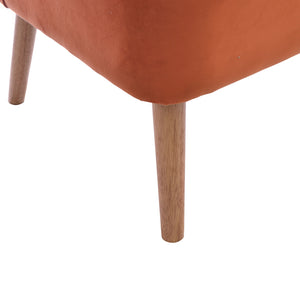 Devi Chair comes in orange with a luxe style and is available from roomshaped.co.uk