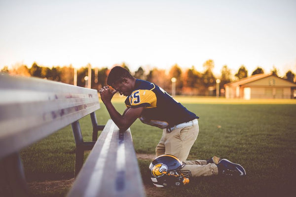 athlete stresses and pray before big game
