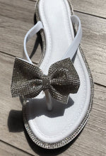 Silver and White Bow Flip Flops
