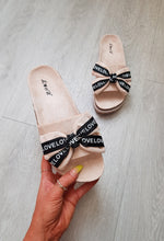 pink and black bow flat sandals