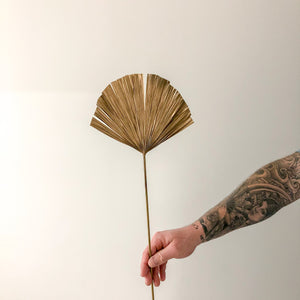 Gold palm leaf fan