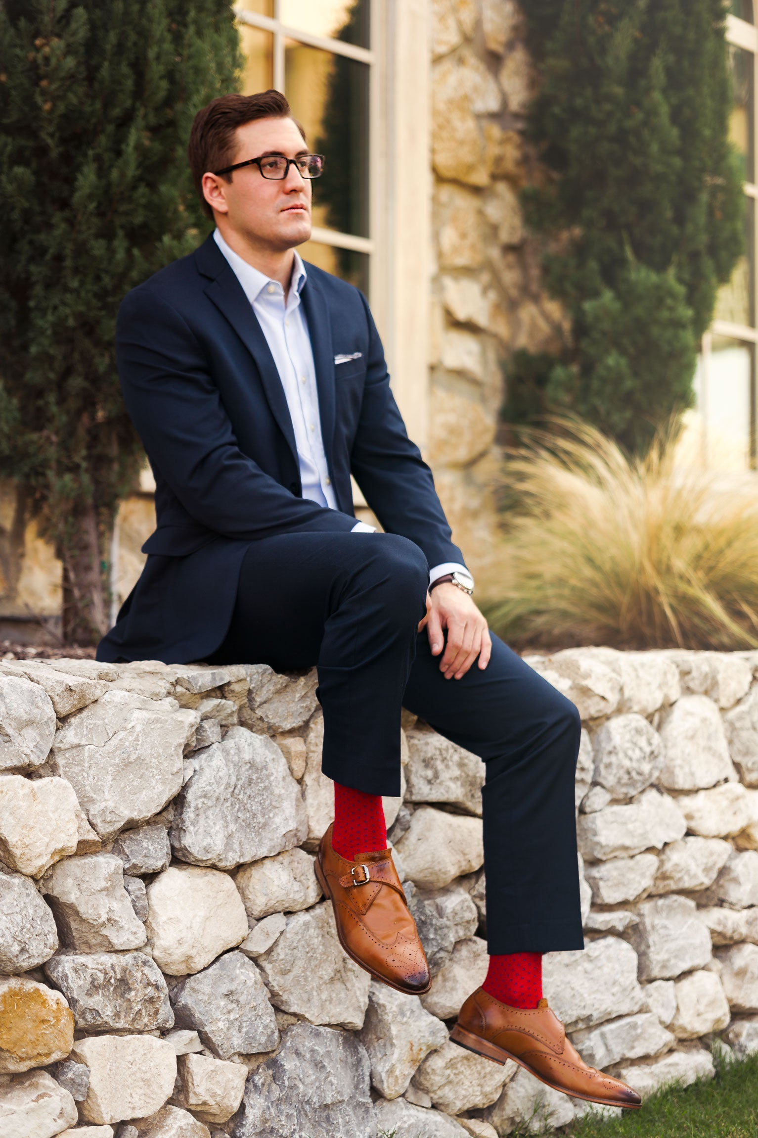 Man in suit shows off awesome socks