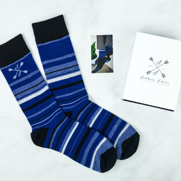 Blue striped socks with brown shoes