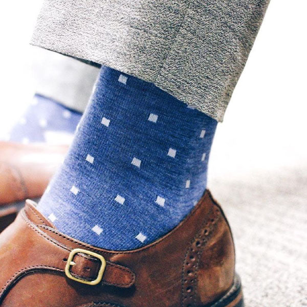 Blue socks with grey slacks and brown shoes