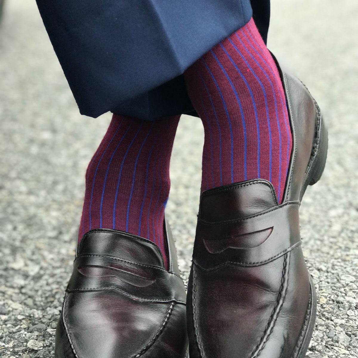 guy wearing blue and red pinstripe dress socks