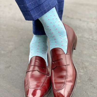 man wearing mint blue socks with pink dots