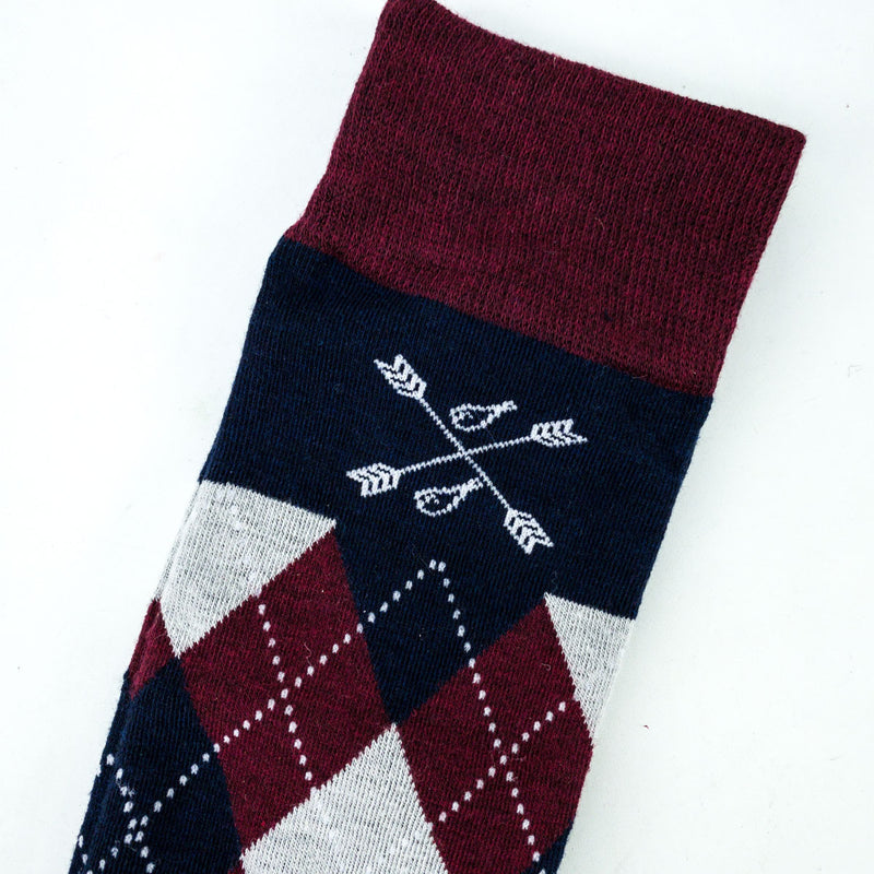 man wearing grey, red, and blue argyle socks