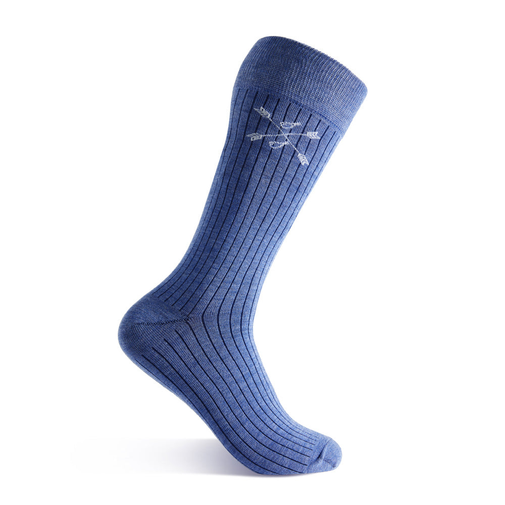 man wearing solid, blue, and navy blue ribbed socks