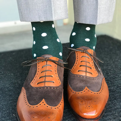 Man wearing green socks and brown shoes