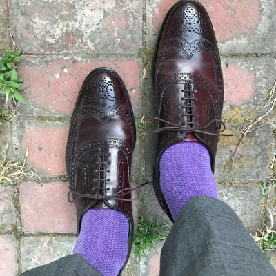 man wearing purple socks