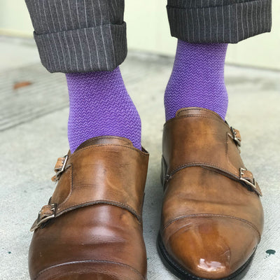 man wearing purple business socks
