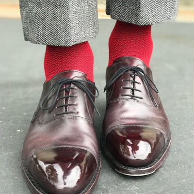Guy wearing red socks and grey pants