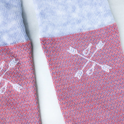 A detail shot of salmon and blue textured and patterned men's socks