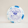 round blue violet goat milk soap on natural background