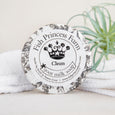 round clean goat milk soap with white towels and plant in background