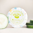 round cucumber goat milk soap on natural background with cucumber slices