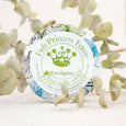 round eucalyptus goat milk soap on natural background with leaves