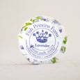round lavender goat milk soap on natural background