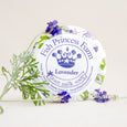 round lavender goat milk soap on natural background with flowers