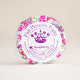 round raspberry goat milk soap on natural background