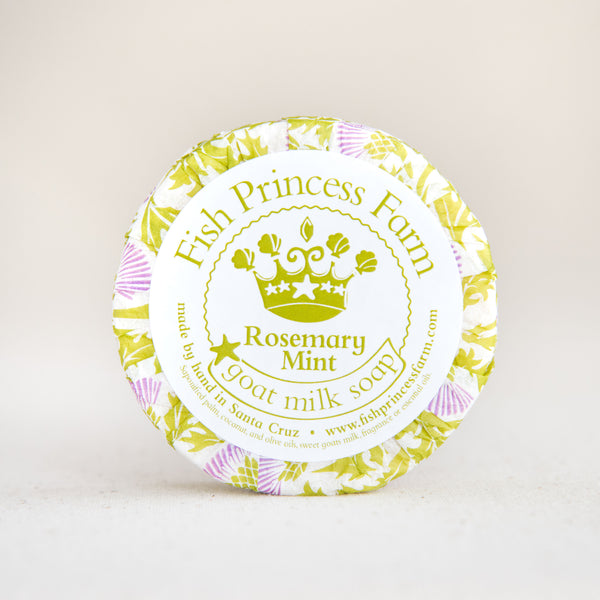 round rosemary mint goat milk soap on natural background
