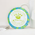 round white tea goat milk soap on natural background with tea pitcher on right