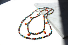 Load image into Gallery viewer, Rainbow Puka with orange pendant beads
