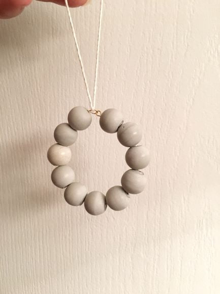 Cement beaded ornament