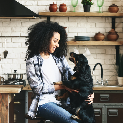Woman and dog in kitchen