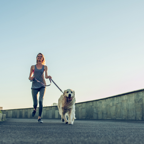 Dog and woman running