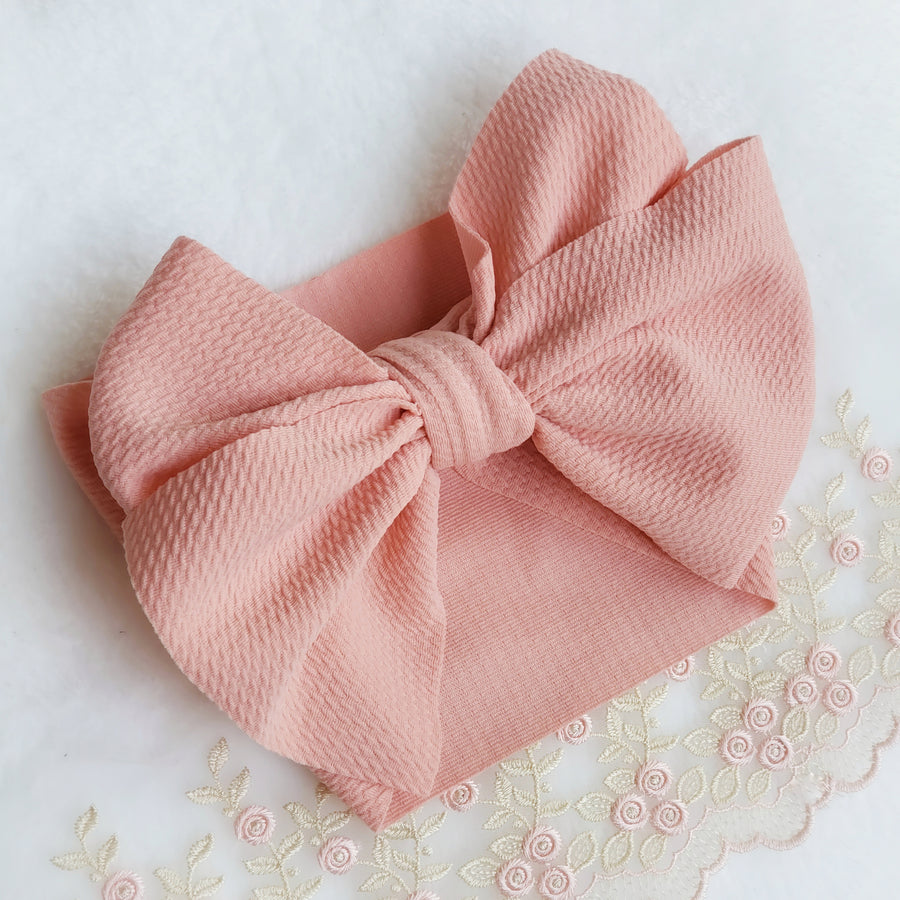 Oversized Knotted Bow Headwrap in Peach Pink