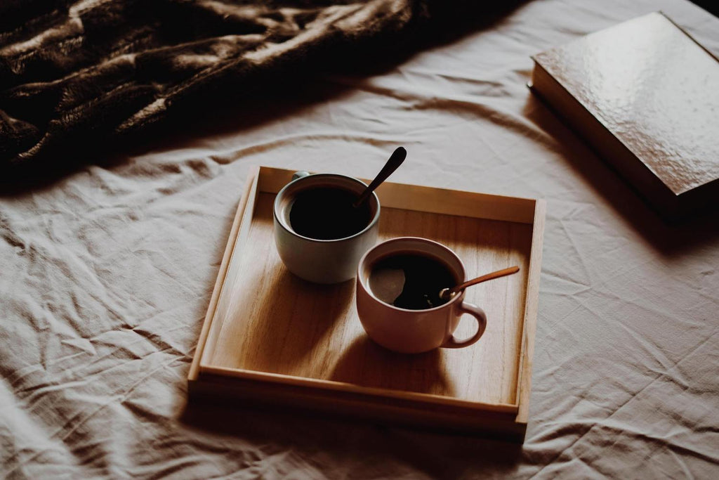 2 cups of coffee on wooden tray
