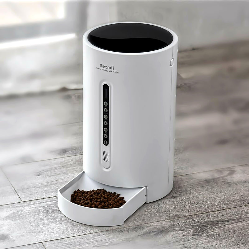 Petmii Smart Pet Cat Dog Feeder with food on a wooden floor
