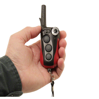 person holding the remote control for the dogtra iQ plus remote training collar