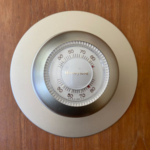 Honeywell Classic Manual Round Thermostat in Taupe.