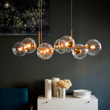 Load image into Gallery viewer, West Elm | Staggered Glass 8 Light Chandelier-Clear Glass in Antique Brass